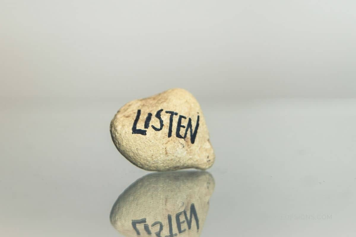 the-word-listen-on-a-pebble-stone